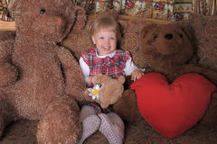 Girl with toy bears Royalty Free Stock Photography