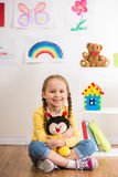 Girl with toy bee Royalty Free Stock Images