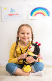 Girl with toy bee Stock Photo