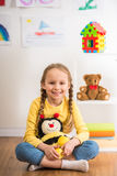 Girl with toy bee Royalty Free Stock Photography