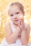 Girl with toy bird and lights bokeh in the background Stock Photo