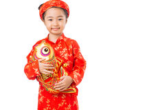 Girl with toy brocaded carp Royalty Free Stock Image