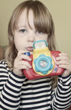 Girl with toy camera. A young child holding a toy camera as if she is about to take a photo Royalty Free Stock Photography