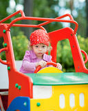 Girl in toy car. Little girl in a toy car cabin - shallow DOF Stock Photos