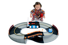 Girl and toy car race track royalty free stock image