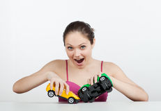 Girl with toy cars Stock Photography