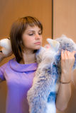 Girl with toy-cat Stock Image