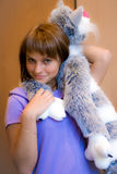 Girl with toy-cat Royalty Free Stock Images
