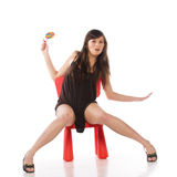 Girl on a toy chair Royalty Free Stock Photos