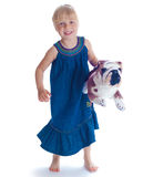 The girl with a toy dog Royalty Free Stock Photo