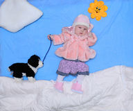 Girl with a toy dog walks winter Royalty Free Stock Photos