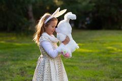 Girl and bunny toy royalty free stock images