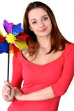 Girl with toy flower. Girl dressed in pink blouse holding a toy flower royalty free stock images