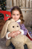 Girl with a toy hare in hands Stock Photo