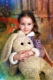 Girl with a toy hare in hands Royalty Free Stock Images