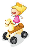 Girl on toy horse Royalty Free Stock Image