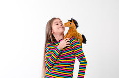 Girl and toy horse Royalty Free Stock Images