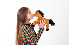 Girl and toy horse Stock Images