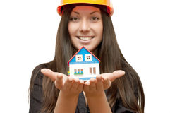 Girl with the toy house Stock Photography