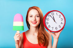 Girl with toy ice cream and clock Stock Image