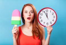 Girl with toy ice cream and clock Stock Photography