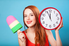 Girl with toy ice cream and clock Royalty Free Stock Photo