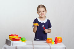 Girl with a toy kitchen pie Stock Photo