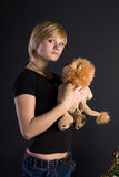 Girl with toy-lion Royalty Free Stock Image