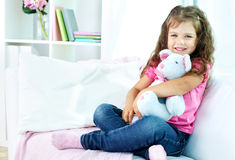 Girl with toy Stock Photos