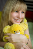 Girl with toy-mouse Stock Images