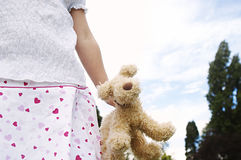 Girl with toy in park. Royalty Free Stock Photos
