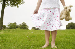 Girl with toy in park. Royalty Free Stock Images
