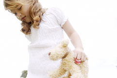 Girl with toy in park. Royalty Free Stock Photo