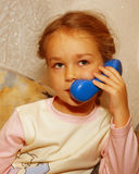 Girl with toy phone Royalty Free Stock Photography