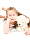 The girl with a toy puppy Royalty Free Stock Images