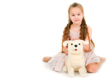 The girl with a toy puppy Royalty Free Stock Photo