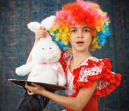Girl with toy rabbit Stock Images