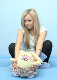 Girl with a toy rabbit Stock Photo