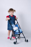 Girl with toy rabbit in baby carriage Royalty Free Stock Images