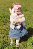 Girl with Toy Rabbit Stock Photography