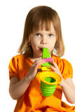 Girl with toy saxophone. Little beauty girl with toy saxophone in her hands on white background stock photo