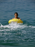 Girl with toy on sea. Girl (teen) wit yellow beach toys on sea royalty free stock image