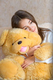 Girl and toy Royalty Free Stock Images