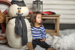 Girl with a toy snowman Royalty Free Stock Photo
