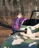 Girl with toy tank Stock Photos