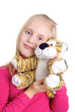Girl with a toy tiger Royalty Free Stock Images