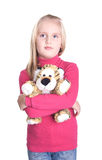Girl with a toy tiger Royalty Free Stock Photo