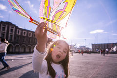 Girl with toy. Toluca. Little girl playing with mexican handicraft toy, Toluca, Mexico stock photography