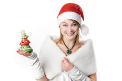 Girl with toy-tree Stock Images