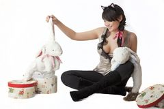 Girl with toy white rabbit Stock Photo